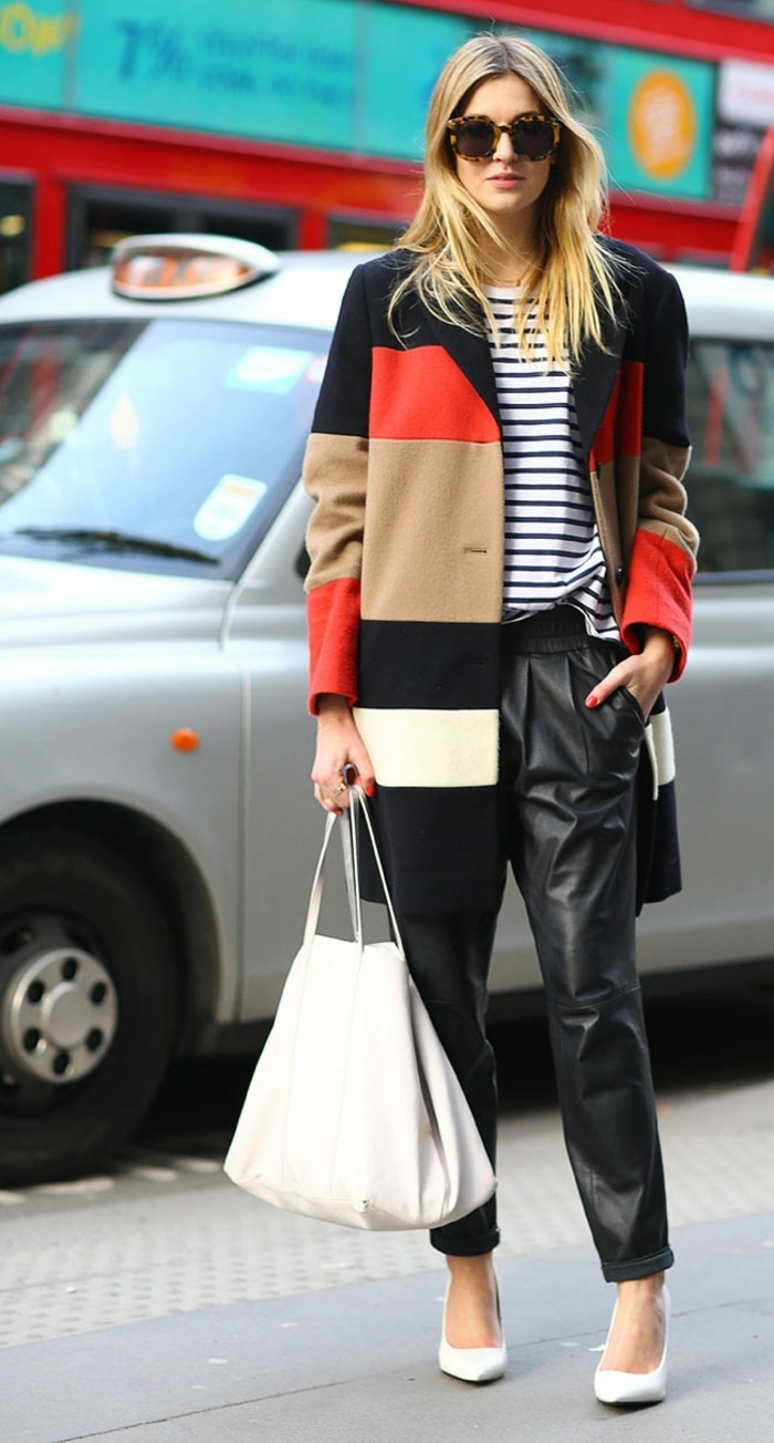business casual for young women, black and red, beige and white block color coat, worn by blond woman with sunglasses, over white and black striped top, and baggy leather trousers with pockets