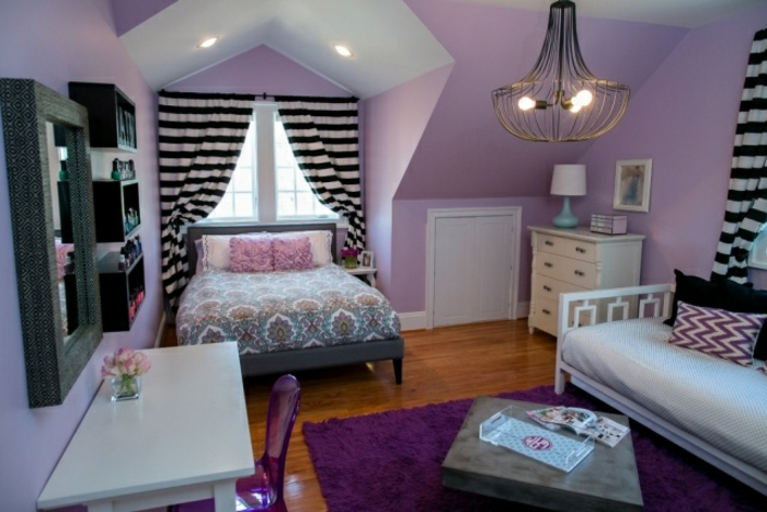 curtains ideas, bedroom with pale purple walls, wooden floor and purple rug, bed and sofa, two windows with black and white striped curtains