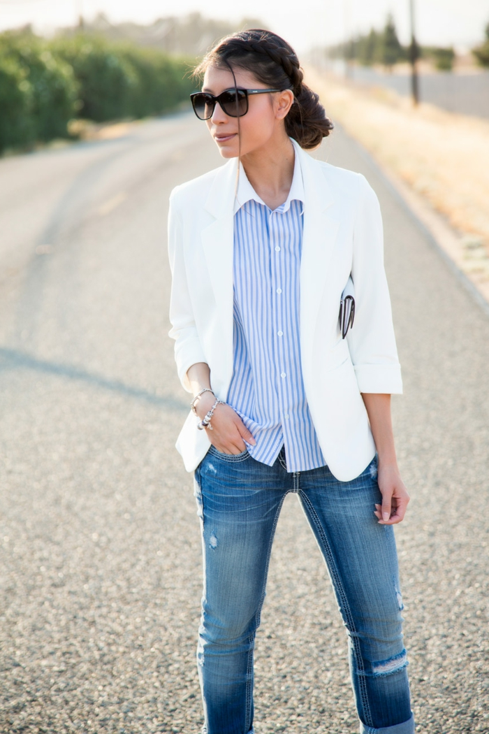 woman with dark hair tied back, wearing white blazer, over pale blue pin stripe shirt, business casual outfits