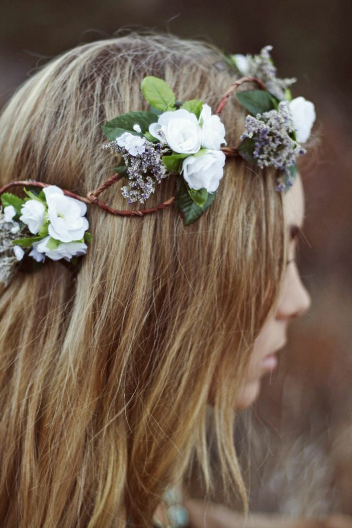 medieval times hair, straight dirty blond hair, decorated with a flower wreath, made from brown twigs, green leaves and white flowers