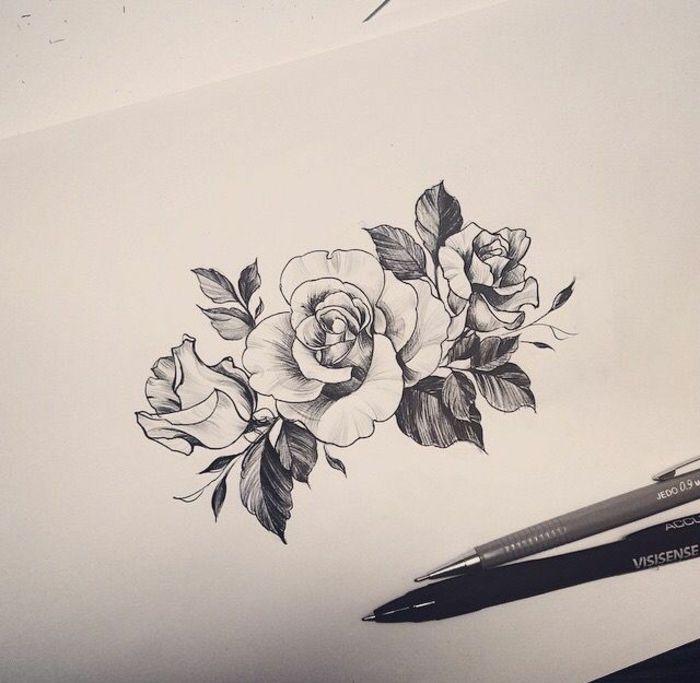 flower tattoo designs, black and white ink drawing of three roses with leaves, pencil and fineliner nearby