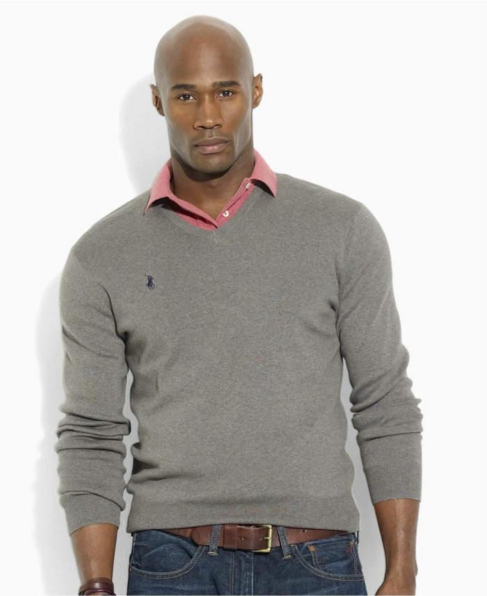atheltic bald man, in business casual attire, with grey polo jumper, worn over pink shirt, and dark jeans, featuring a brown leather belt