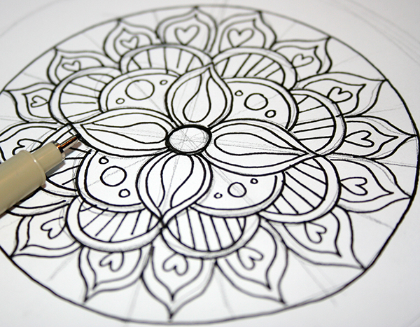 inked drawing of a flower mandala, black ink and pencil on white paper, craft ideas, fineliner nearby