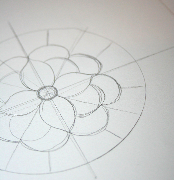 flower with many pettals, drawn in pencil, in the middle of a circle, with several crossing lines, craft ideas