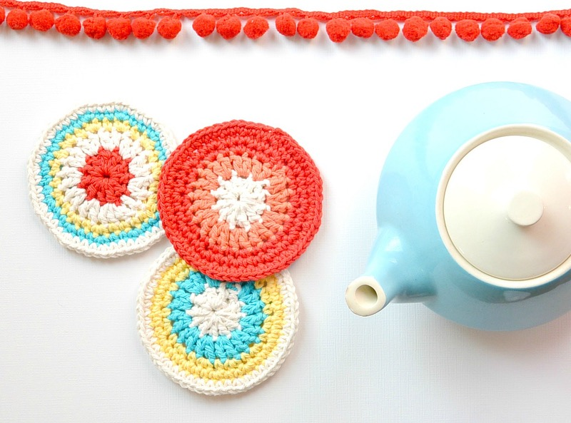 knitted coasters in red and white, white blue yellow and red, easy arts and crafts, near light blue and white teapot