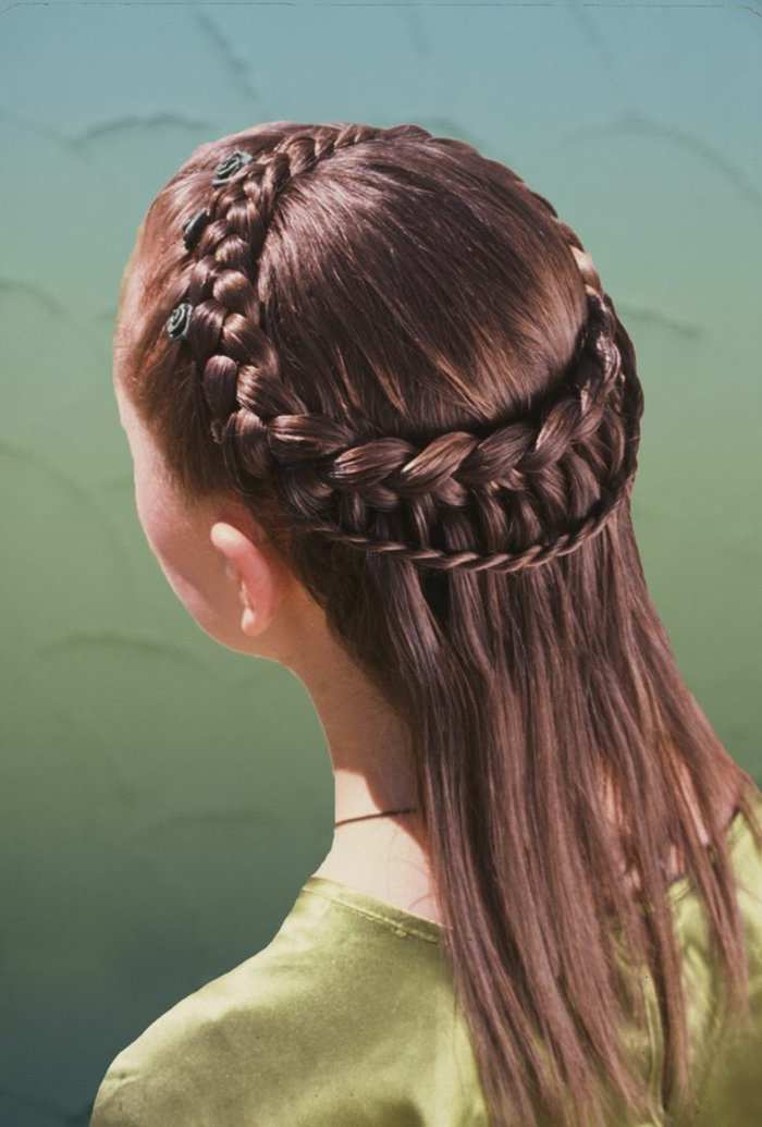 straight brunette hair, with two rows of differently sized braids at the top, going round the head like a crown, decorated with tiny black rose ornaments