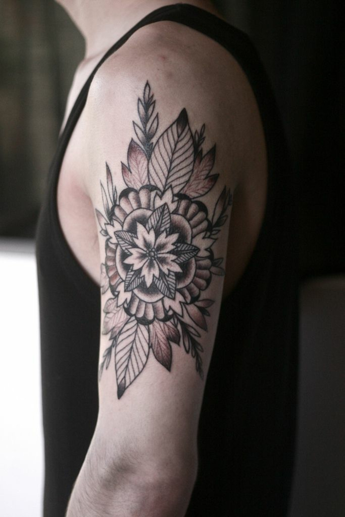 shoulder flower tattoos, man in black tank top, with floral mandala tattoo, with petals and leaves, outlined with black ink, and shaded with brown