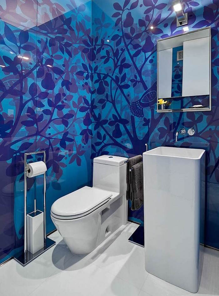 bathroom ideas, toilet with modern white toilet seat, unusual tall white sink, white floor and blue tiles, with dark blue pear trees and birds pattern
