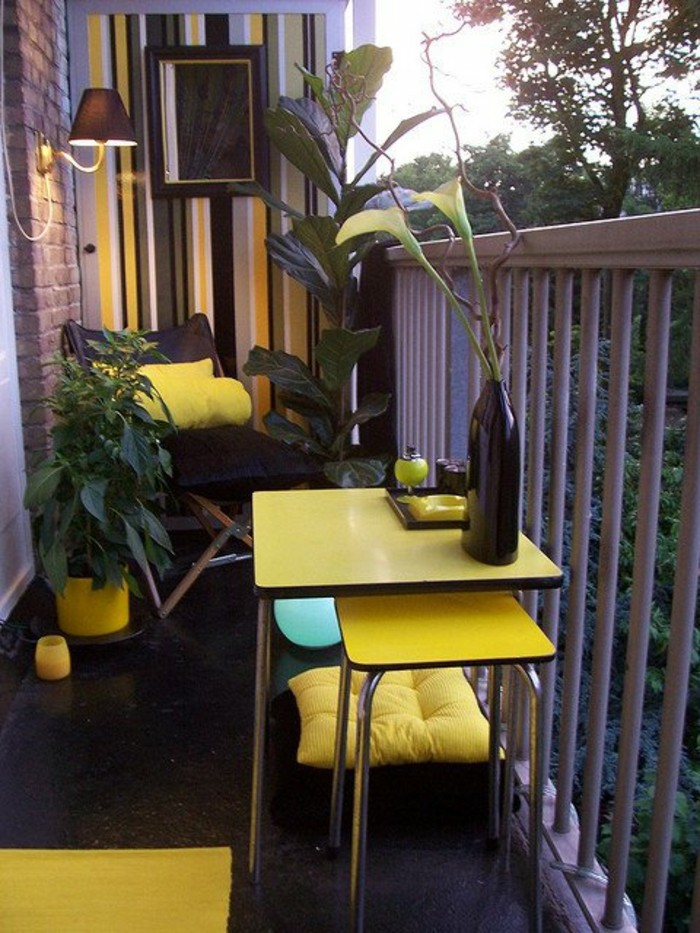 tiny square yellow table, with matching chair underneath, black lounging chair with yellow cushion, porch ideas, grey white black and yellow wallpaper