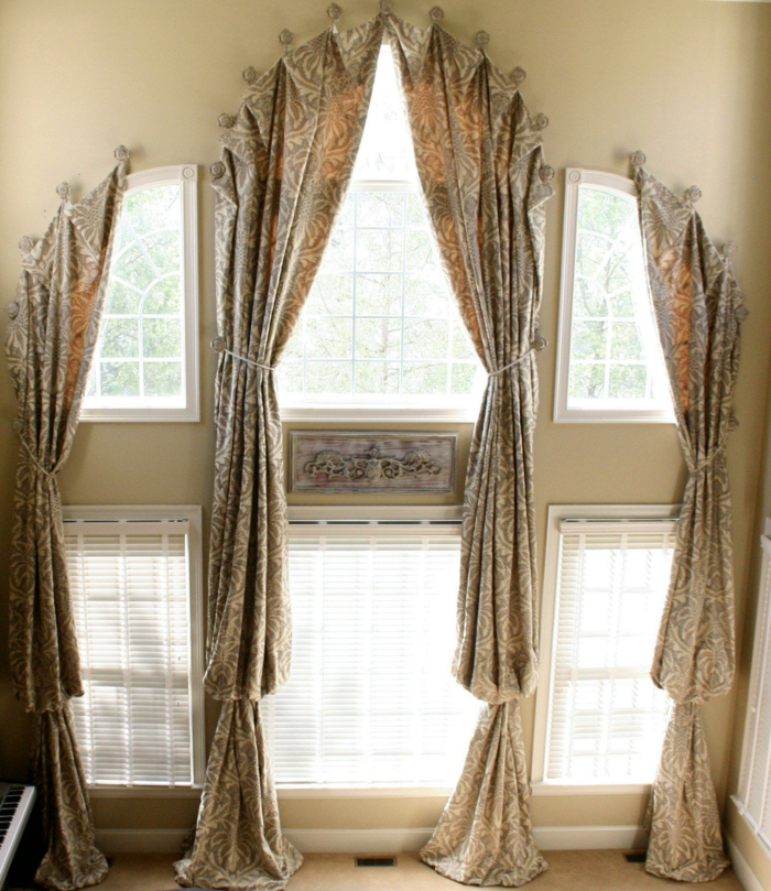 curtains for living room, two story windows, decorated with light brown and cream patterned curtains, bottom row windows have white blinds
