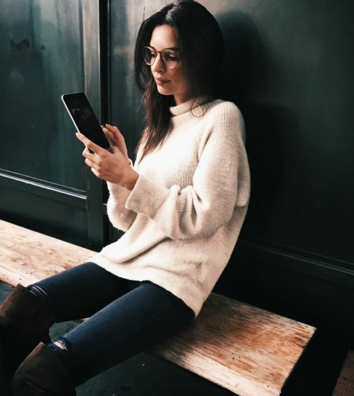 business casual women, brunette woman with glasses, wearing soft pale cream chunky knit turtleneck sweater, over dark torn jeans, and brown suede over-the-knee-boots