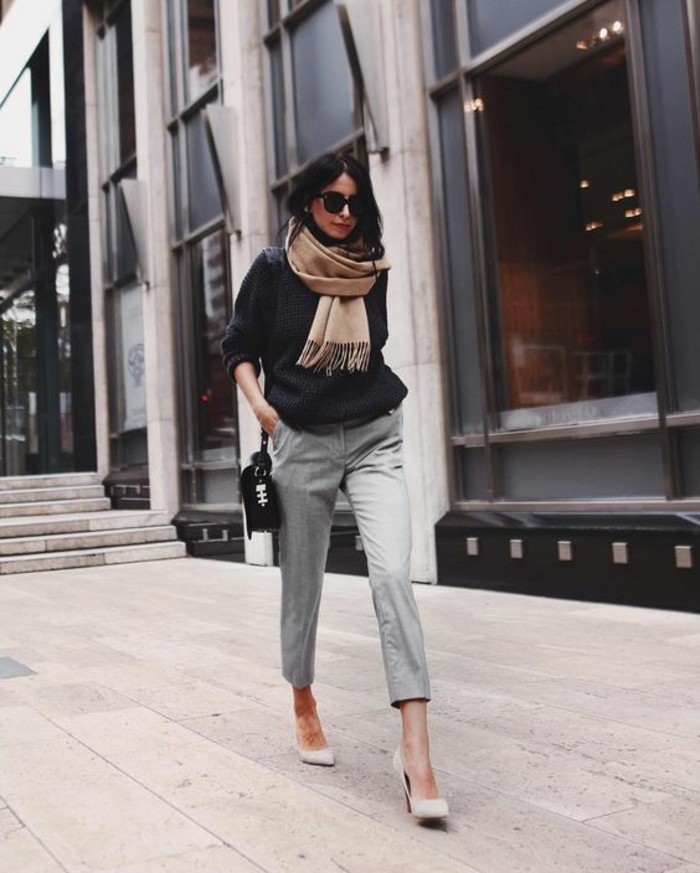 business casual women, brunette with sunglasses, wearing light grey woolen ankle trousers,and dark grey chunky knit sweater, with white heels and beige woolen scarf