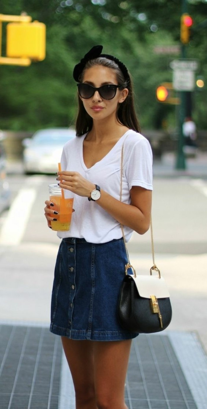 cute work outfits, button up dark denim mini skirt, with white v-neck t-shirt, worn by brunette woman, with sunglasses and black hairband
