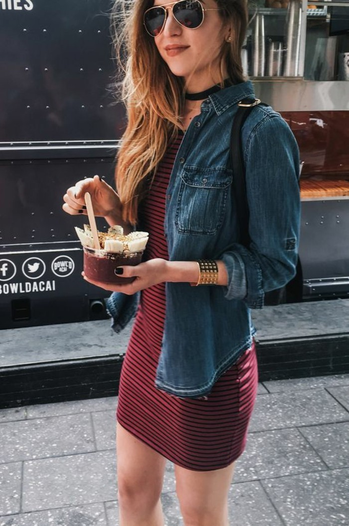 casual dress code, dark denim jacket with rolled sleeves, worn over a red and black striped jersey mini dress, by blonde young woman with sunglasses