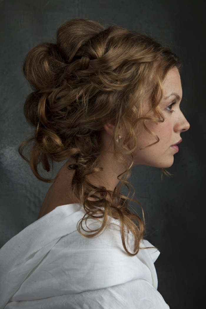 medieval times hair, woman in profile, with brunette hair styled in an unusual hairdo, featuring loose curly strands, and twisted sections