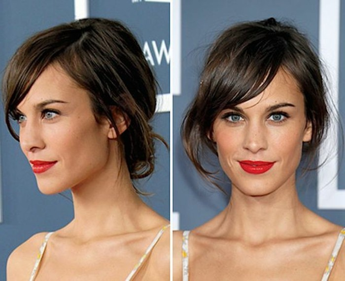 two images of alexa chung, seen from different angles, with hair put up, and side-swept bangs, dark brown hair colors, wearing bright red lipstick, and a pale strappy top