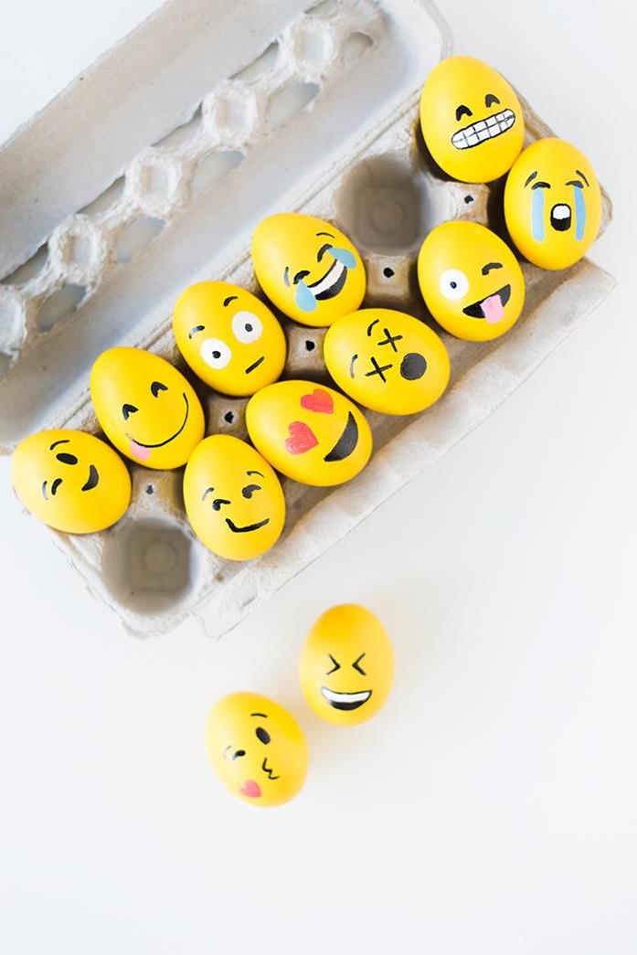 emoji easter eggs, dyed in yellow, faces hand-painted with black, red white and blue marker