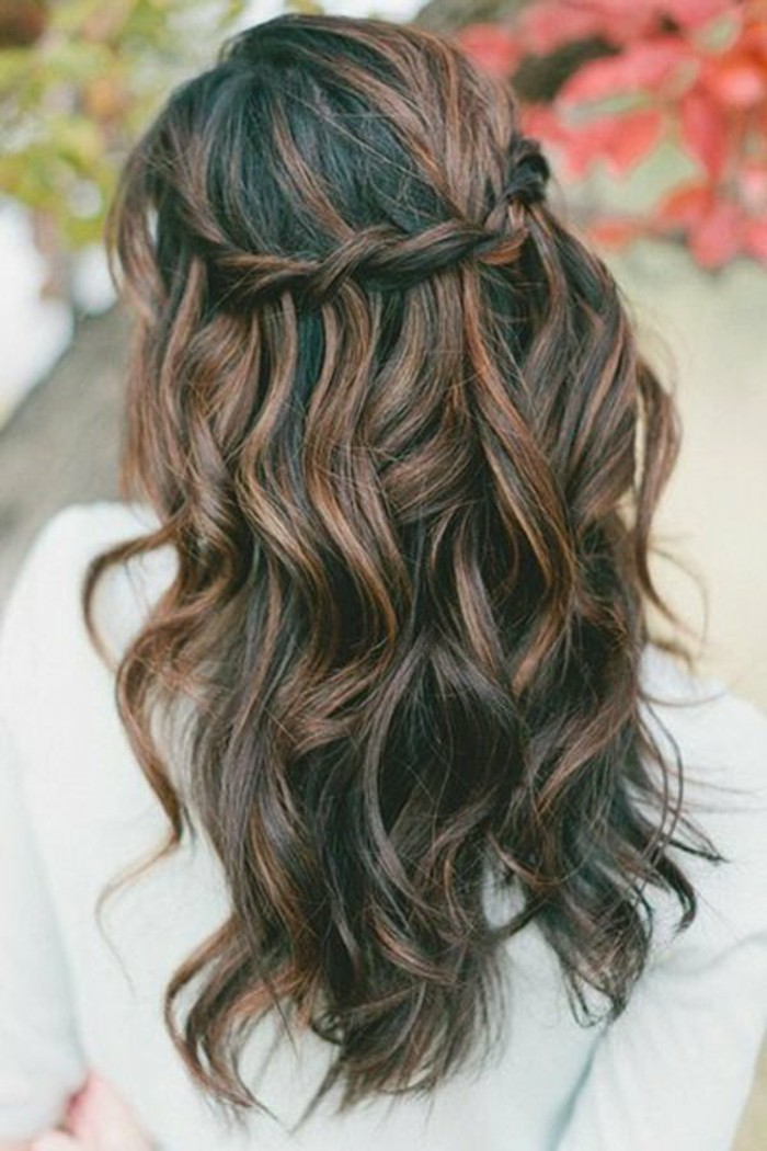 braided and curled hair, brunette hair colors, dark brown with reddish brown highlights, on woman in white jumper