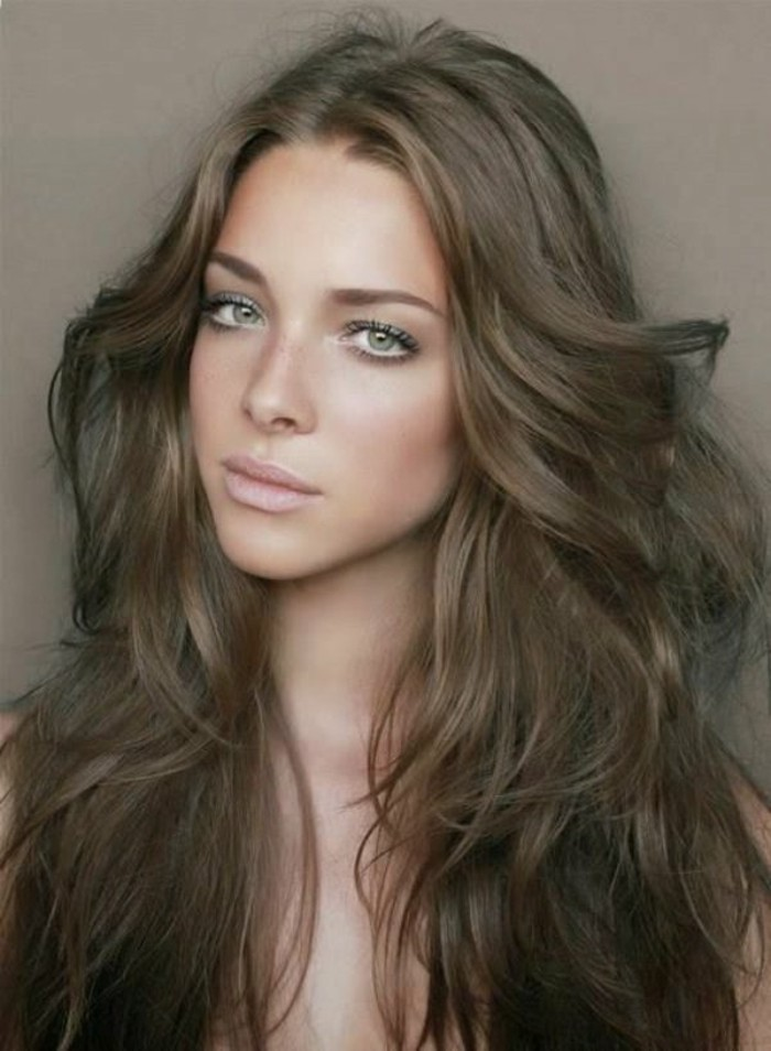 nude lipstick, discreet eye make up and blush, worn by woman with wavy, light brown hair, styled with 70s sweeps