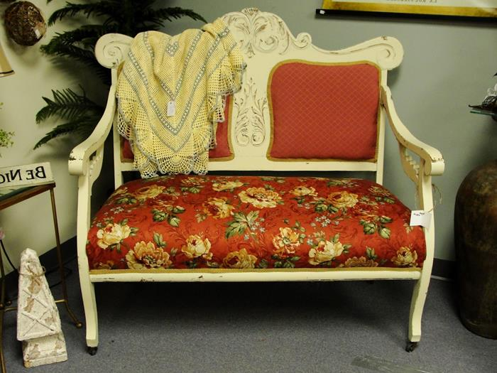 throw in yellow and pale blue, on cream and red french sofa, settee cushion features a red, orange and green floral print