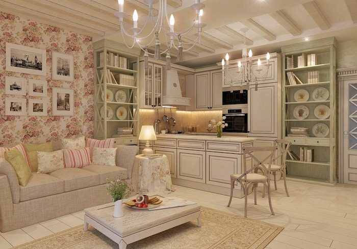 floral wallpaper in white and pink, in living room, white wooden floor, beige rug and shabby sheek sofa, cupboards in pale green and off-white