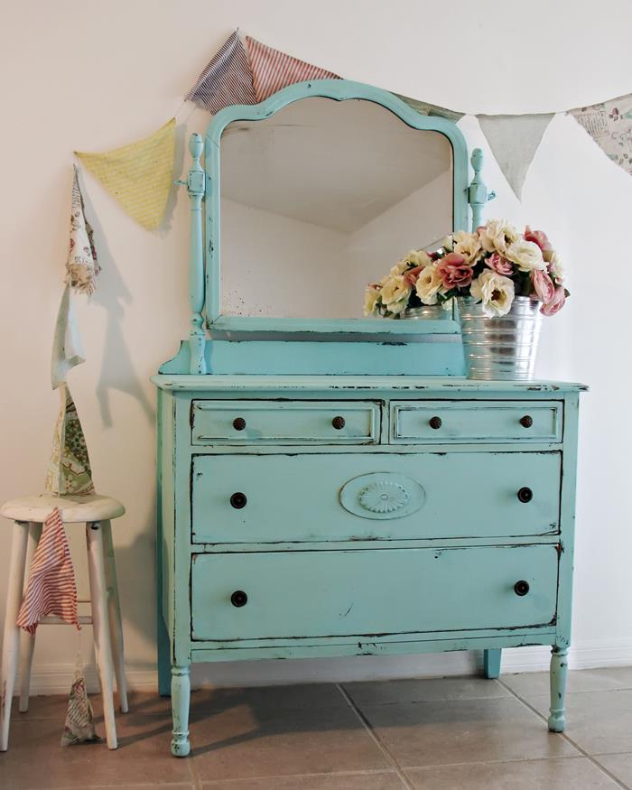 teal antique dresser with mirror, country chic décor, two small drawers and two large ones, pink and white peonies in a silver-colored bucket