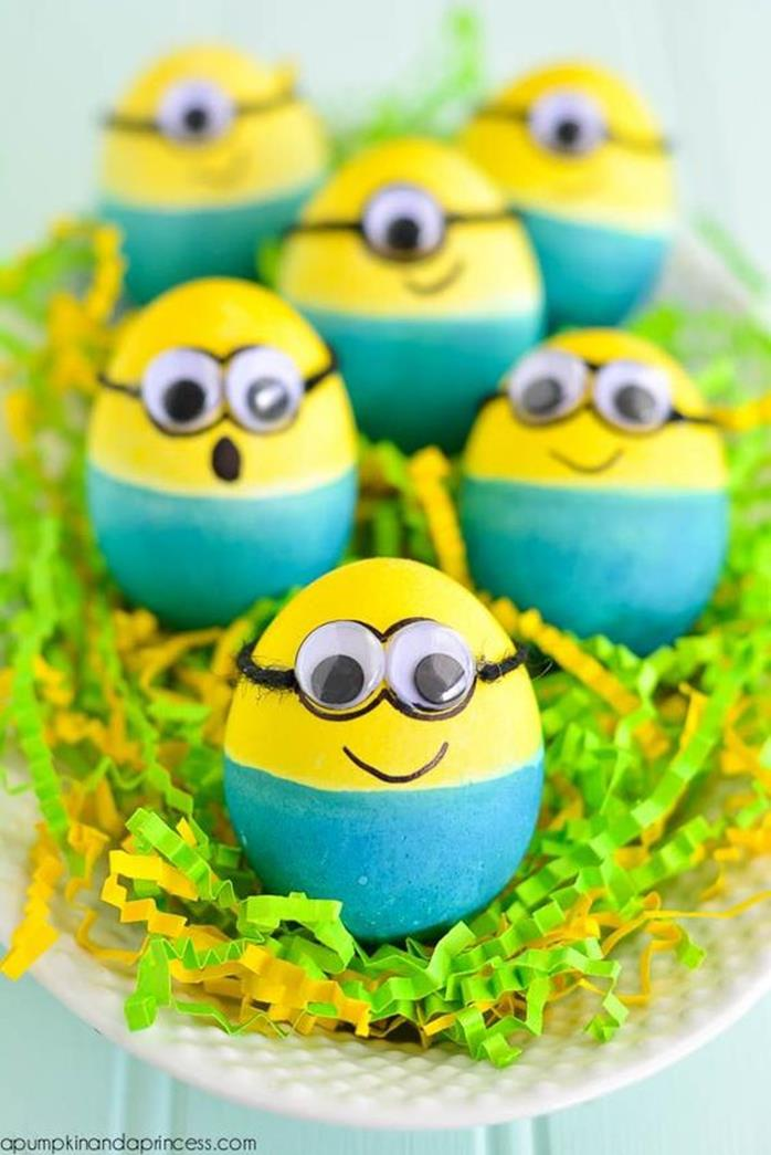 children's easter crafts idea, six eggs painted blue and yellow, and decorated with sticky eyes and marker, to look like minions