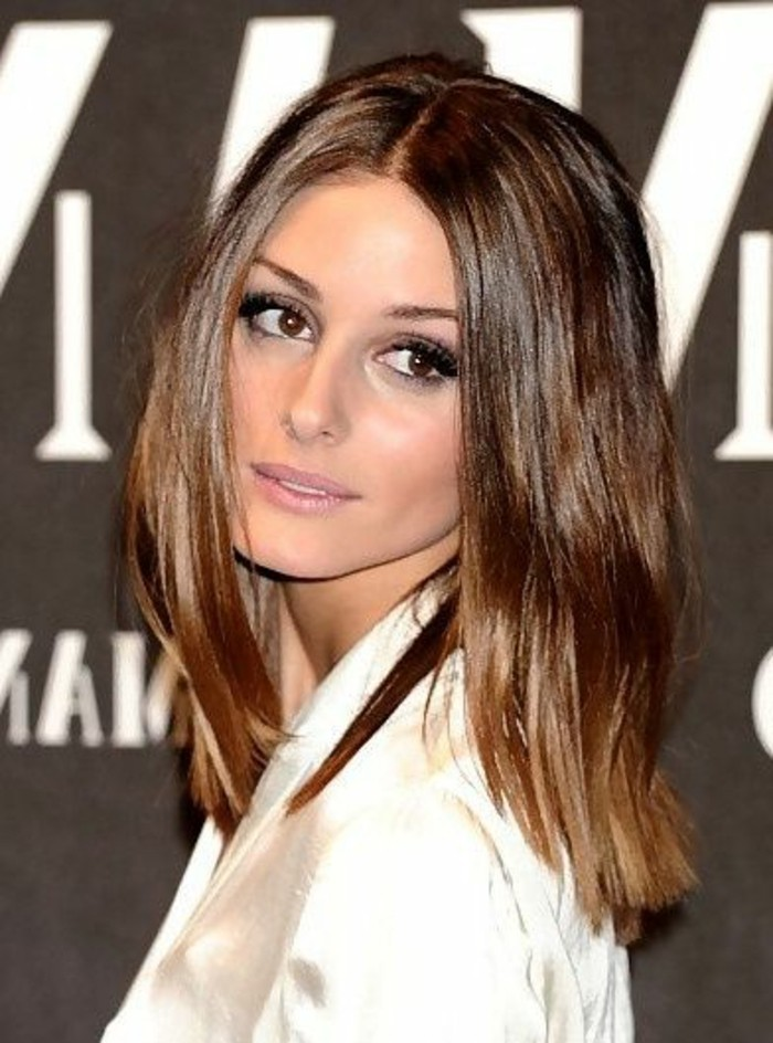 white shiny shirt, worn by olivia palermo, with chocolate brown wavy hair, parted in the middle, brunette hairstyles, pale purple eye make up