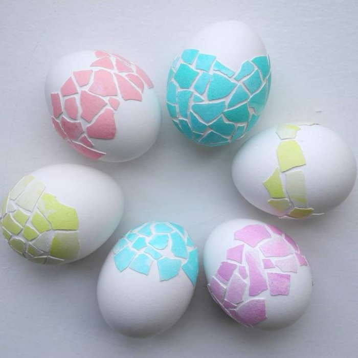 pieces of shells from colored eggs, in green pink and teal, used as decoration on white eggs