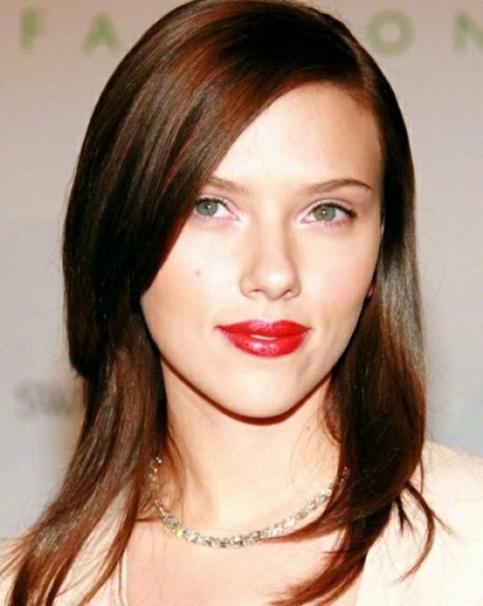 reddish-brunette medium length brown hair, with a side parting, layered and straight, worn by scarlett johansson, with bright red lipstick