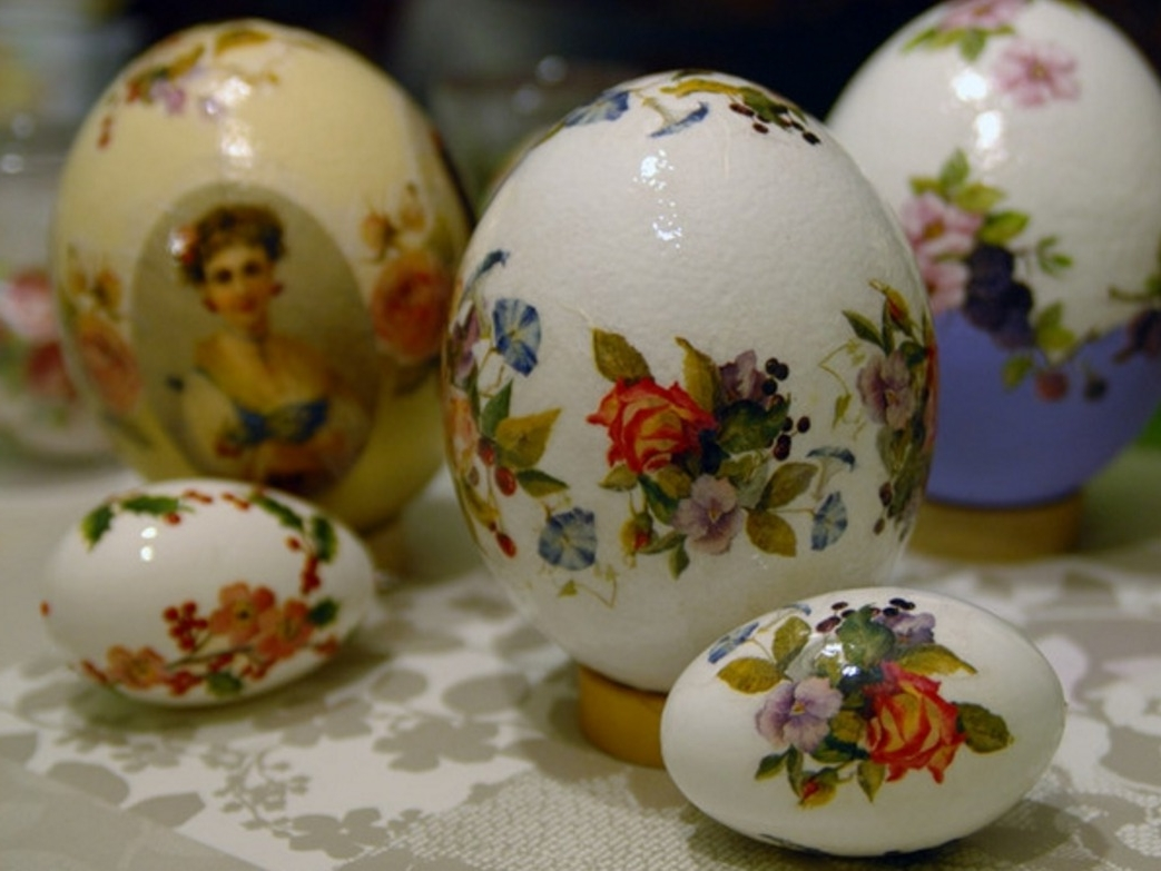 stickers depicting a woman, roses and other flowers, on white and yellow eggs, of different sizes, easter egg coloring and decorating