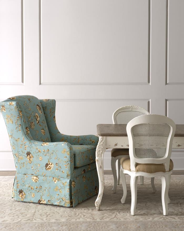 shabby sheek, armchair with pale blue fabric, decorated with grey and yellow floral pattern, near antique table in white and brown, with two matching chairs