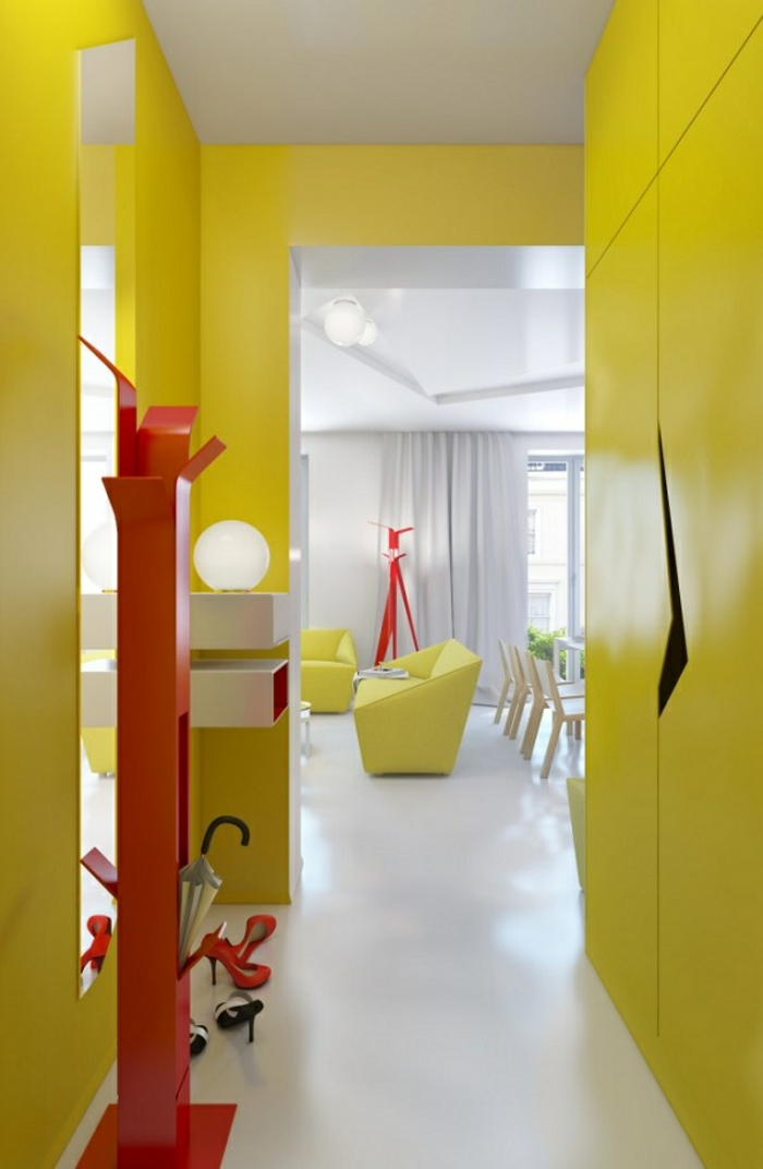 yellow walls and wardrobe, inside a small hall, with bright red coat hanger, hallway decor ideas, white smooth floor, livingroom in the background