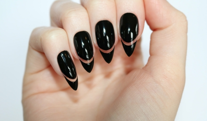 cleverly designed manicure, smooth and shiny, long and sharp, black stiletto nails, with decorative see-through lines