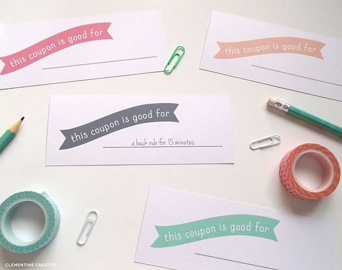 coupons for mother's day, made from white card, with pink and orange, turquoise and gray banners, to be filled in, washi tape and pencils
