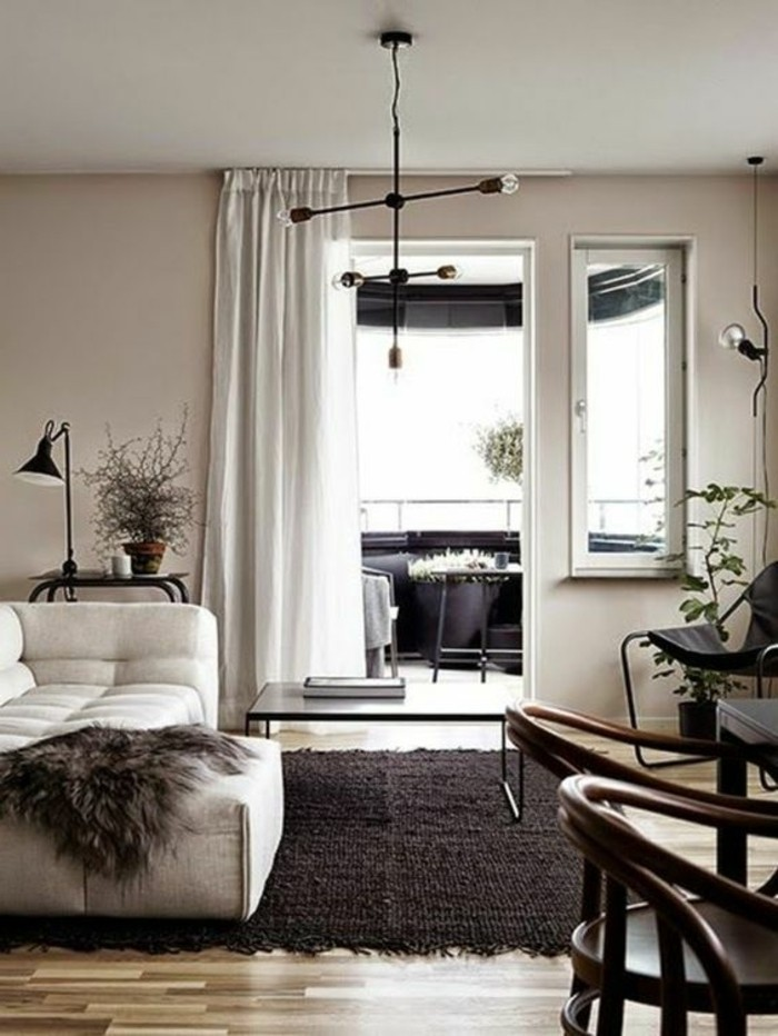 open terrace near room with beige-gray walls, off-white sofa with dark gray animal skin throw, dark brown rug, living room color ideas