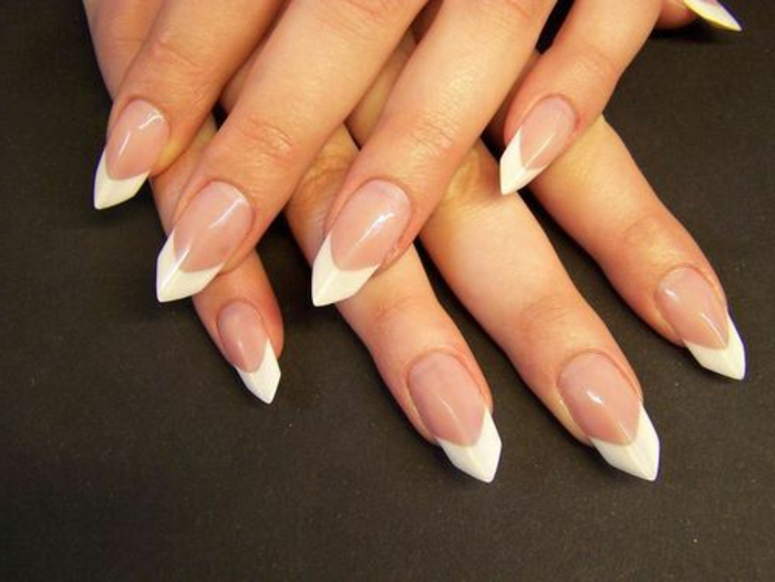 triangular tips painted in white, on long nails, coated with clear nail polish, french manicure style