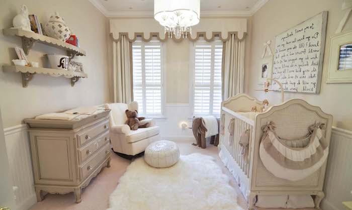 off-white and pale beige baby nursery, with vintage crib, and matching changing table with drawers, armchair and toys