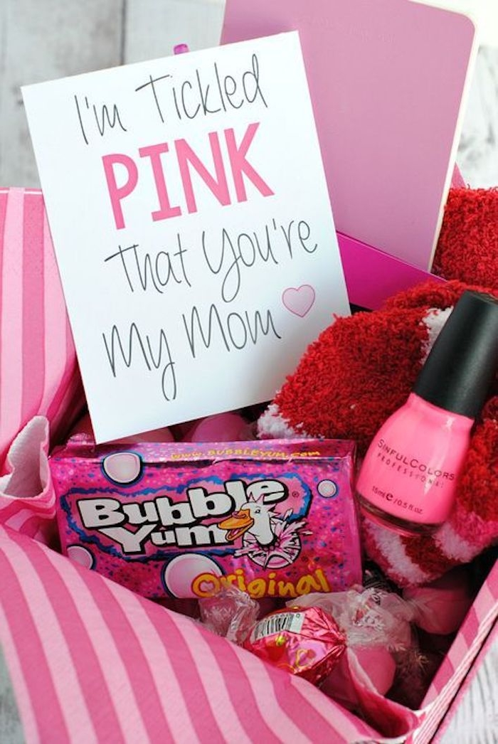 bubblegum and sweets, nail polish and socks, mother's day card, all in pink shades, inside pink striped gift box