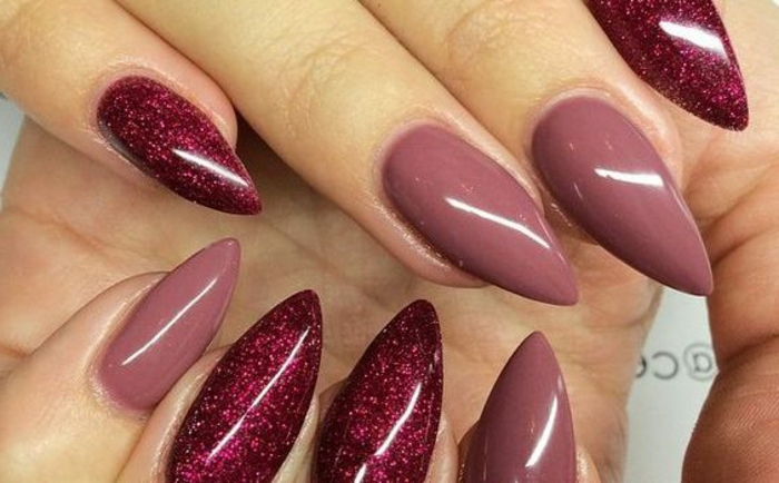 close up of nails, in glittering red, and rose ash pink, sharp oval manicure, chic and understated