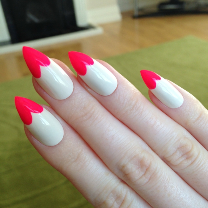 tips painted in red, to look like hearts, on long and sharp manicure, painted in white nail polish, stilleto nail designs, valentine's day idea
