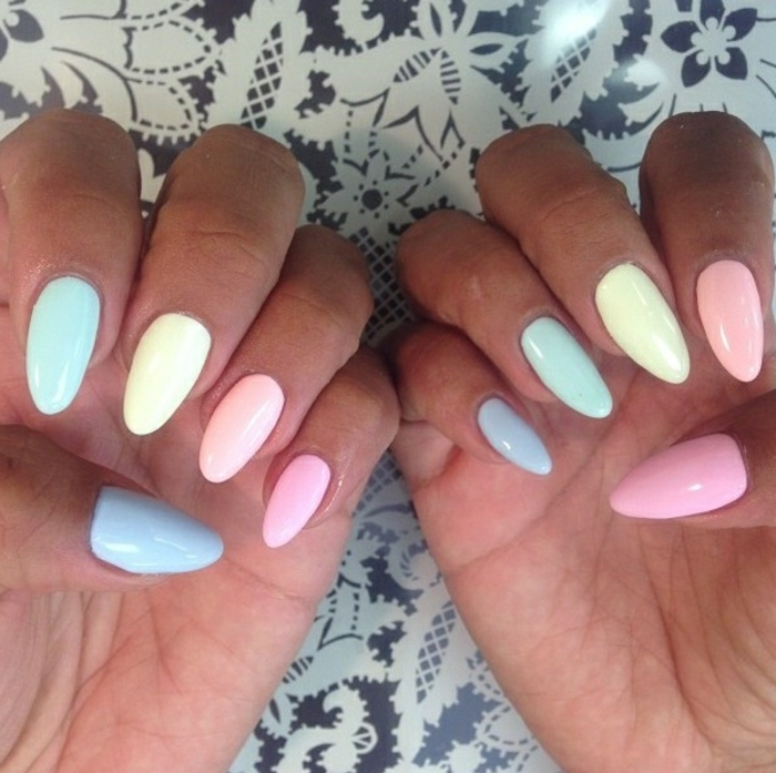 cute pale pastel pink nail polish in blue, pink and green, yellow and orange, on long oval manicure