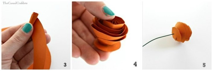 twisting and folding orange paper, to form a rose-like shape, attaching the paper flower to a wire stalk, mothers day presents, easy diy flower tutorial