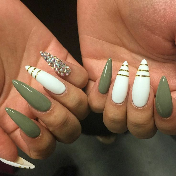 olive green and white, sharp and long stiletto nails, decorated with golden stripes, and rhinestone stickers