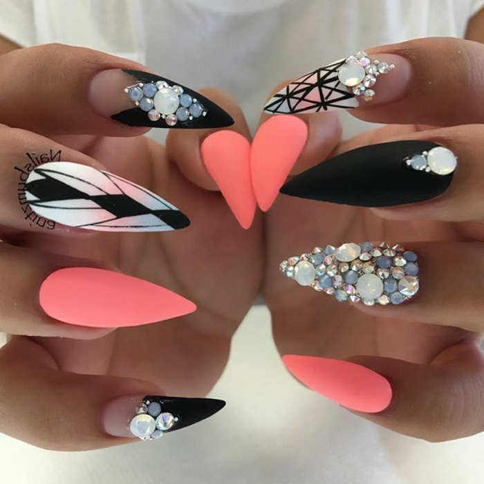 light neon pink, and black stiletto nails, with clear nail polosh details, hand-drawn geometric patterns, pearl and rhinestone stickers