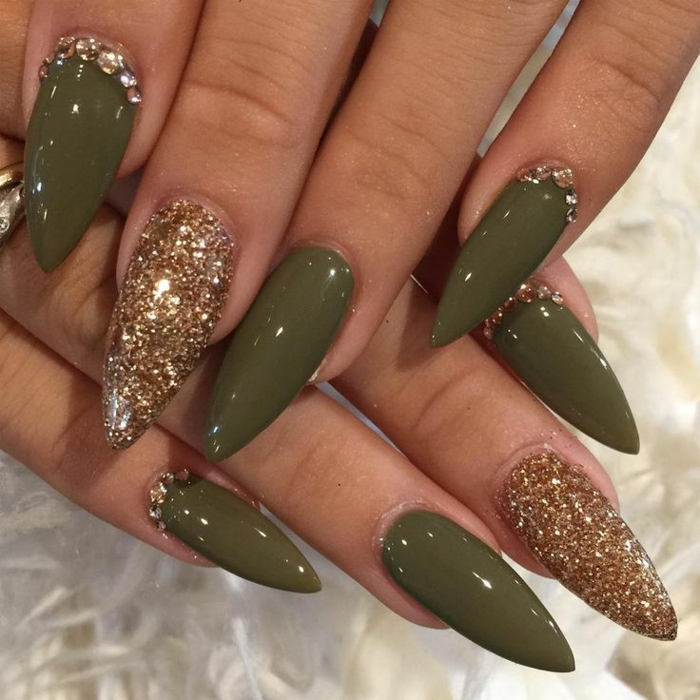 golden glitter and rhinestone stickers, stilleto nail designs, on sharp manicure with smooth, shiny olive green nail polish