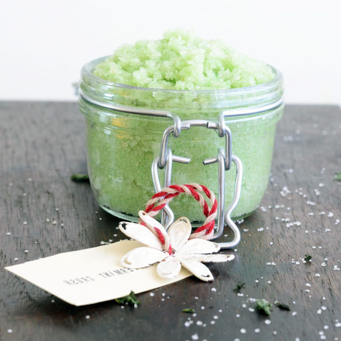 foot scrub in pale green, inside small clear mason jar, with snap close, mothers day presents, decorated with white and red thread, label and paper flower