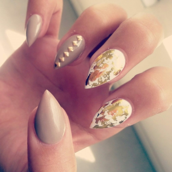 gold leaf and golden nail decals, on sharp and short stiletto nails, painted in grey and white nail polish