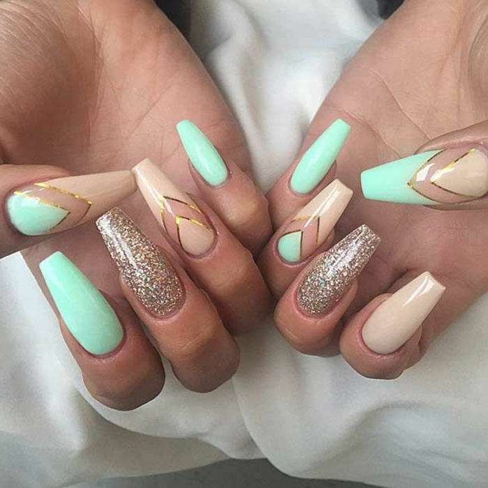 square or rectangular claw nails, decorated with pastel turquoise, and pale pastel pink nail polish, with golden glitter and details