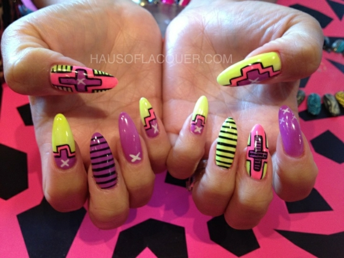 eighties or nineties style, retro manicure in neon colors, with stripes and crosses, and asymmetrical shapes, on long stiletto nails